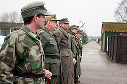 Reenactors portraying German panzer Grenadiers parade for roll call at Eden Camp Malton Nr Pickering<br />