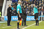 The ref talks to the fourth official as objects are thrown on to the pitch during the Sky Bet Championship match between Derby County and Birmingham City at the iPro Stadium, Derby, England on 16 January 2016. Photo by Aaron Lupton.