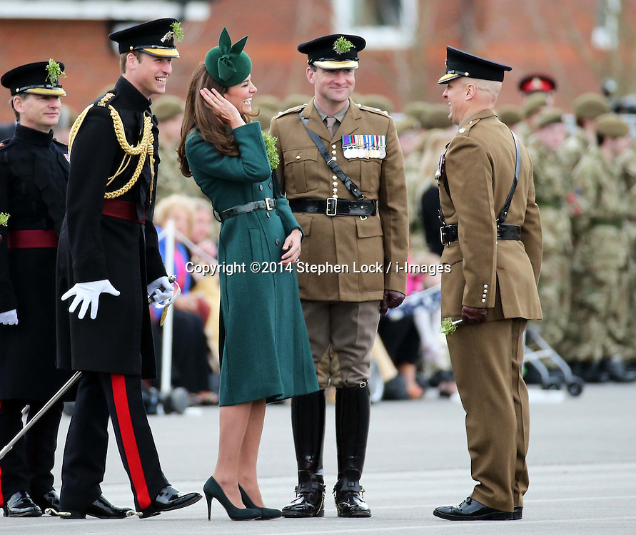 The Duke and  Duchess of Cambridge at the Irish Guards' St.Patrick's Day Parade in Aldershot, United Kingdom. Monday, 17th March 2014. Picture by Stephen Lock / i-Images