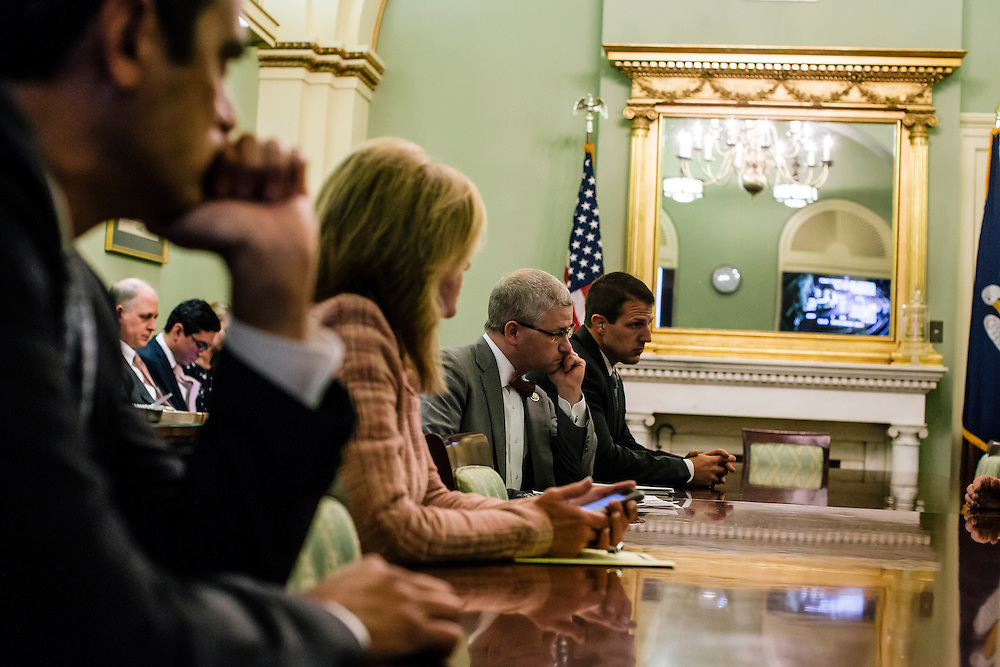 U.S. Rep. Patrick McHenry (R-N.C.), the chief deputy whip of House Republicans, talks with fellow republicans at a weekly deputy whip meeting at the U.S. Capitol on April 23, 2015. McHenry is considered one of the fastest-rising stars of House Republicans.
