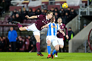 Christophe Berra (#6) of Heart of Midlothian stretches to head the ball clear under pressure from Eamonn Brophy (#25) of Kilmarnock during the Ladbrokes Scottish Premiership match between Heart of Midlothian and Kilmarnock at Tynecastle Stadium, Gorgie, Scotland on 27 February 2018. Picture by Craig Doyle.
