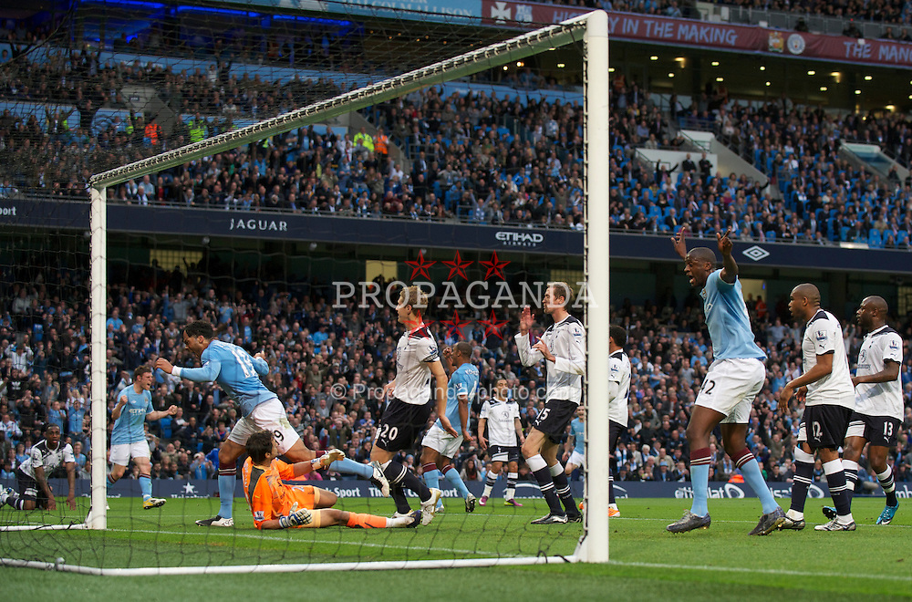 MANCHESTER, ENGLAND - Monday, May 10, 2011: Tottenham Hotspur's Peter Crouch puts the ball past his own goalkeeper Carlo Cudicini scoring on own goal during the Premiership match against Manchester City at the City of Manchester Stadium. (Photo by David Rawcliffe/Propaganda)