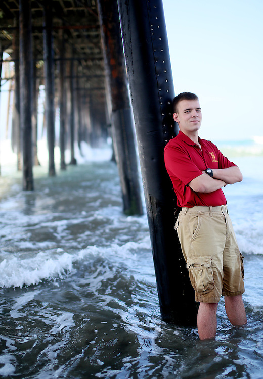 Connor Stotts stands underneath the Oceanside Pier where he saved some peoples lives who were drowning, Saturday, May 17, 2014 in Oceanside, CA.(Photo by Sandy Huffaker for The American Legion)