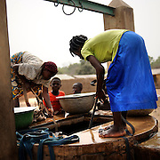 Beninese woman collect water from the well at the village of Kpataba, Benin February 24, 2008.