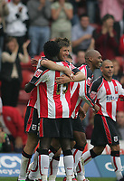 Photo: Lee Earle.<br /> Southampton v Plymouth Argyle. Coca Cola Championship. 16/09/2006. Southampton's Grzegorz Rasiak is congratulated after scoring the opening goal
