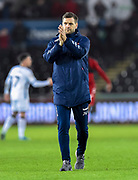 Middlesbrough manager Jonathan Woodgate applauds the travelling fans at full time during the EFL Sky Bet Championship match between Swansea City and Middlesbrough at the Liberty Stadium, Swansea, Wales on 14 December 2019.