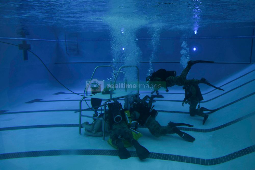 Special Tactics Airmen demonstrate dive techniques to U.S. Air Force Gen. Paul J. Selva, vice chairman of the Joint Chiefs of Staff, during an Air Force Special Operations Command immersion at Hurlburt Field, Florida, July 17, 2018. Special Tactics operators are the Air Force's premiere special operations ground force and are highly trained to deploy whenever they are needed into restricted environments by air, land or sea to conduct air power on the frontlines, to save lives and ensure mission success. (U.S. Air Force photo by Airman 1st Class Dennis Spain)