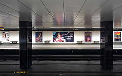 Glasgow, Scotland, UK. 1 April, 2020. Effects of Coronavirus lockdown on Glasgow life, Scotland. Empty platforms at St Enoch subway station. Posters on wall advertising concerts that will now be cancelled.