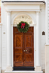 December 21, 2017 - Charleston, South Carolina, United States of America - A wooden door on a historic home decorated with a Christmas wreath on King Street in Charleston, SC. (Credit Image: © Richard Ellis via ZUMA Wire)