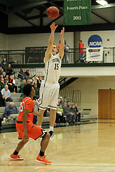 17 November 2015:  Brady Rose(15) shoots for a long 3 pointer during an NCAA men's division 3 CCIW basketball game between the Greenville College Panthers and the Illinois Wesleyan Titans in Shirk Center, Bloomington IL