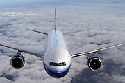 Boeing 777-200, in flight, head on