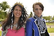 Garden City, New York, U.S. - June 14, 2014 -  A teen boy dressed as Ciel Phantomhive and a woman from Huntington wearing a Princess Zelda costume are outside at Eternal Con, the annual Pop Culture Expo, with costumes, Comic Books, Collectibles, Gaming, Sci-Fi, Cosplay, Horror. It was held at the Cradle of Aviation Museum, which is behind them.