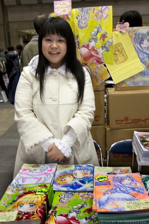 """ROZEN MAIDEN"" manga stall. The designer and writer ""Saya Asahina"" has been publishing her comic for 15 years. The story is about ""Love between Doll and Human"" as she described it. TOKYO COMIC MARKET ""COMIKET"" the biggest comic market in Japan. Independent designers come to sell their comics, there is anime, manga, cosplay, toys, posters etc. At ""Tokyo Big Sight"" exhibition center."