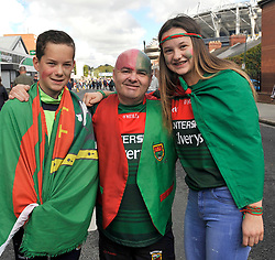 Jack, Kevin and Emily Concannon from Knock at the All Ireland Football Final<br /> Pic Conor McKeown