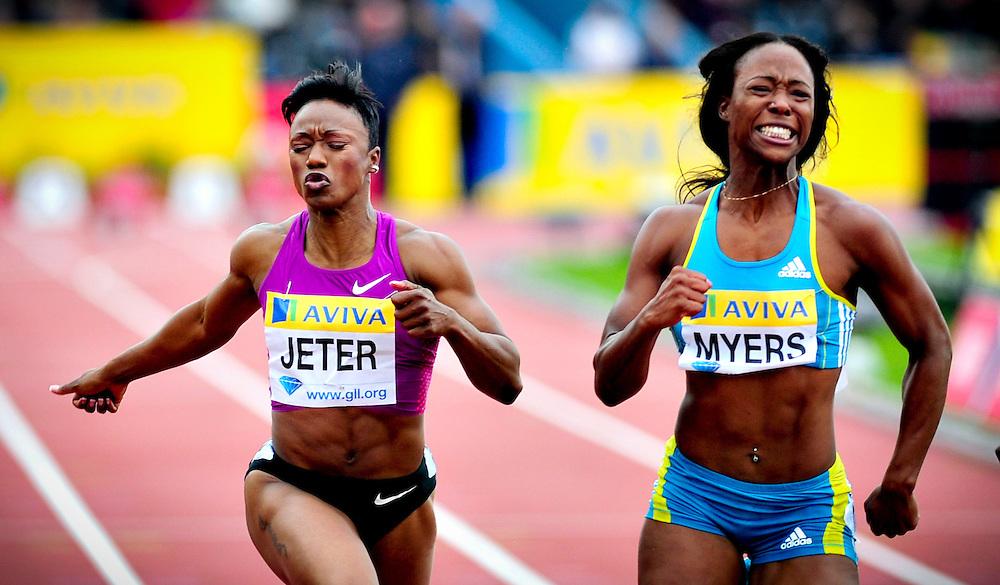 USA's Marshevet Myers (R) and Carmelita Jeter (L) cross the finish line of the women's 100m final
