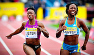 USA's Marshevet Myers (R) and Carmelita Jeter (L) cross the finish line of the women's 100m final