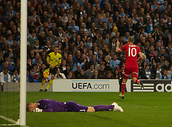02.10.2013 Manchester, England.  Man City keeper Joe Hart feels the pain as Bayern Munich's Arjen Roben Celebrates his goal to make it 3-0 during the Group D UEFA Champions League game between, Manchester City and Bayern Munich from the Etihad Stadium.
