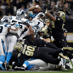 Jan 7, 2018; New Orleans, LA, USA; Carolina Panthers quarterback Cam Newton (1) reaches for extra yardage against New Orleans Saints defensive tackle Sheldon Rankins (98) during the second quarter in the NFC Wild Card playoff football game at Mercedes-Benz Superdome. Mandatory Credit: Derick E. Hingle-USA TODAY Sports