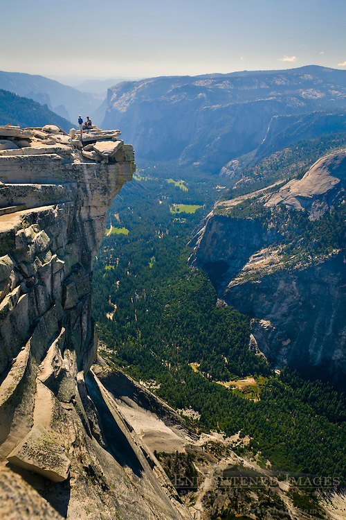 Hikers on the Visor at the top of Half Dome looking over Yosemite Valley, Yosemite National Park, California