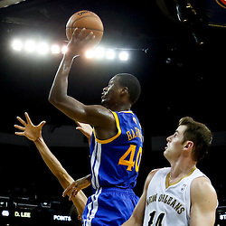 Nov 26, 2013; New Orleans, LA, USA; Golden State Warriors small forward Harrison Barnes (40) shoots over New Orleans Pelicans center Jason Smith (14) and power forward Anthony Davis during the second half of a game at New Orleans Arena. The Warriors defeated the Pelicans 102-101. Mandatory Credit: Derick E. Hingle-USA TODAY Sports