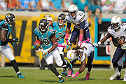 Jacksonville Jaguars running back Jordan Todman (30) returns a kickoff during an NFL game against the San Diego Chargers at EverBank Field on Oct. 20, 2013 in Jacksonville, Florida. San Diego won 24-6.<br /> <br /> ©2013 Scott A. Miller