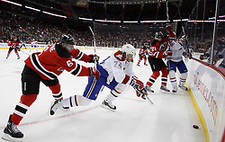 Dec 16, 2009; Newark, NJ, USA; New Jersey Devils defenseman Andy Greene (6) checks Montreal Canadiens left wing Sergei Kostitsyn (74) while battling for the puck during the first period at the Prudential Center.