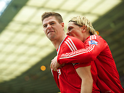 BIRMINGHAM, ENGLAND - Sunday, April 4, 2010: Liverpool's captain Steven Gerrard MBE celebrates scoring the opening goal against Birmingham City with team-mate Fernando Torres during the Premiership match at St Andrews. (Photo by David Rawcliffe/Propaganda)