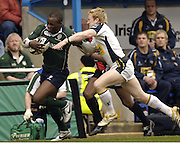 Reading, Berks, ENGLAND, 15.04.2006, Topsy Ojo, tackler, Tom Biggs, Guinness Premiership, London Irish vs Leed Tykes, Madejski Stadium,  © Peter Spurrier/Intersport-images.com.
