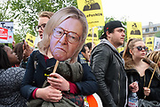 France, Paris, 1 May 2017. May Day march. Since the presidential 2nd round election will be held in a week, a group protests against far-right candidate Marine Le Pen.