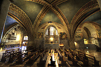 Basilica church of St. Francis of Assisi.  Lower church's vaulted ceilings at the Basilica di San Francesco feature masterpieces of the early Sienese school of painting.