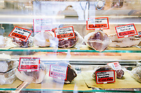 NAPLES, ITALY - 4 JANUARY 2019: Cold-cuts are seen here at the counter of Janarius, a restaurant in Naples, Italy, on January 4th 2019.<br /> <br /> Janarius is a typical Neapolitan gourmet restaurant and shop founded by Francesco Andoli in September 2018 in via Duomo, in front of the Naples's Duomo and treasure of Saint Janarius. Saint Janarius is the patron saint of Naples.