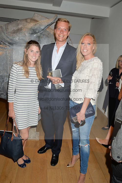 Left to right, SELINA KELLY, EDWARD RITCHIE and his sister ANNIE RITCHIE at a private view of work & workings of Nic Fiddian Green - The Studio held at Sladmore Contemporary, 32 Bruton Place, London on 9th June 2015.