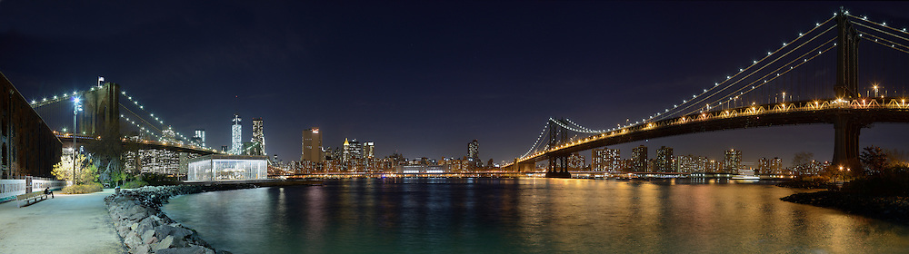 Panorama of East River at night.