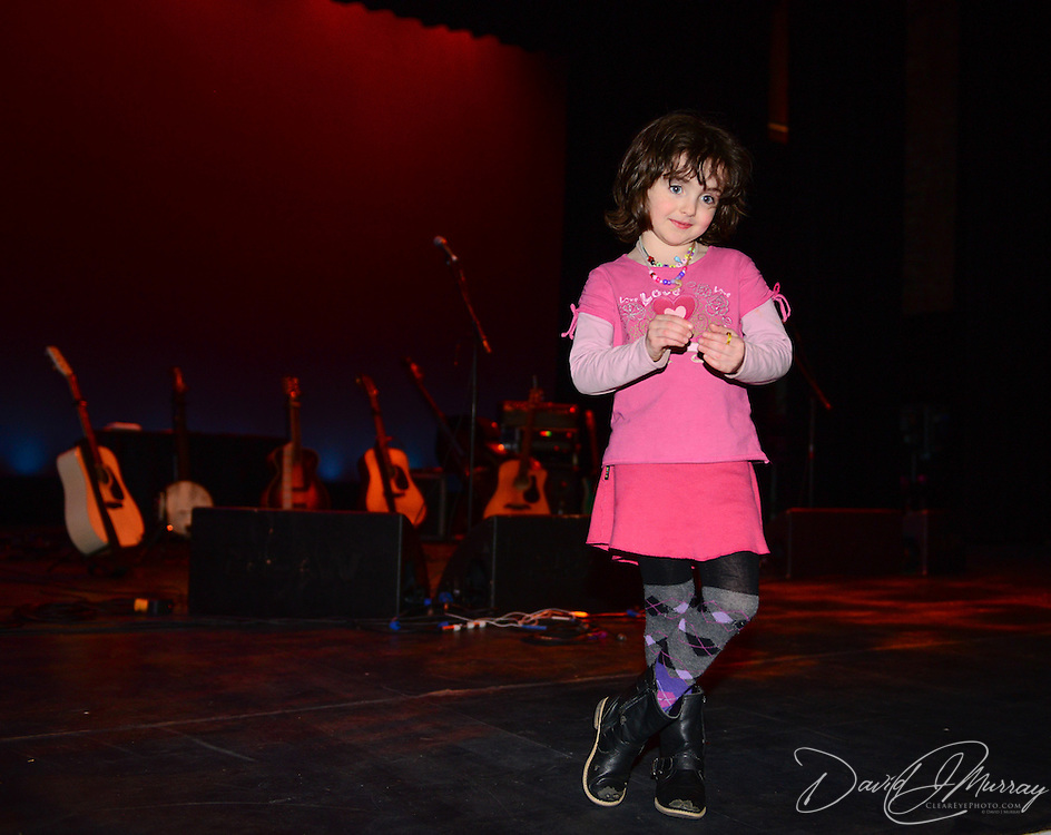 A MH staff relative struts her stuff on stage before John Prine's concert in the 2013 Portsmouth Singer Songwriter Festival at The Music Hall in Portsmouth, NH, on April 20, 2013