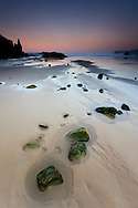 Dusk on the beach of La Franca, Asturias (Spain)