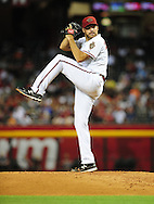 June 14 2011; Phoenix, AZ, USA; Arizona Diamondbacks starting pitcher Josh Collmenter (55) delivers a pitch against the San Francisco Giants at Chase Field. Mandatory Credit: Jennifer Stewart-US PRESSWIRE