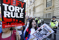© Licensed to London News Pictures. 10/06/2017. London, UK. People protest against Prime Minister Theresa May's new government and a coalition with the DUP outside Downing Street in London on Saturday, 10 June 2017 as the UK snap general election leads to a hung parliament. Photo credit: Tolga Akmen/LNP