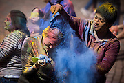 Varun Reddy covers Sneha Pandya in blue powder during the traditonal Indian celebration Holi.  Ohio University students gathered to celebrate the festival of color on Saturday March 15, 2014. which celebrates harmony and unity through diversity.   Photo by Ohio University / Jonathan Adams