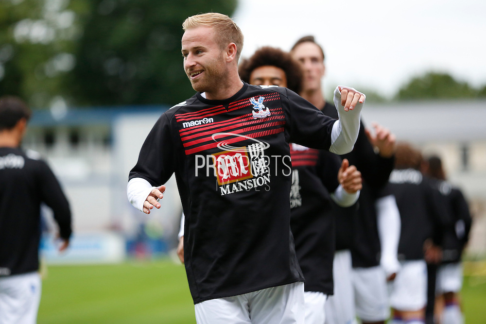 Barry Banna smiling during the warm up before the Pre-Season Friendly match between Hampton & Richmond and Crystal Palace at Beveree Stadium, Richmond Upon Thames, United Kingdom on 27 July 2015. Photo by Michael Hulf.