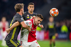 10-04-2019 NED: Champions League AFC Ajax - Juventus,  Amsterdam<br /> Round of 8, 1st leg / Ajax plays the first match 1-1 against Juventus during the UEFA Champions League first leg quarter-final football match / Daniele Rugani #24 of Juventus, Dusan Tadic #10 of Ajax