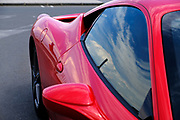 Shiny Red sports car abstract view of the side door and window