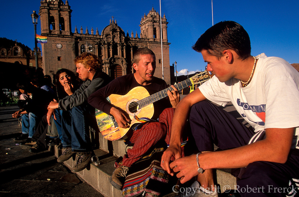 PERU, HIGHLANDS, CUZCO foreign students in the Plaza de Armas