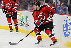 Jan 17; Newark, NJ, USA; New Jersey Devils wing Brad Mills (11) skates with the puck during the first period at the Prudential Center.