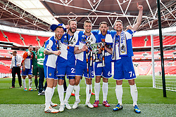 L-R Matt Taylor, Andy Monkhouse, Lee Brown, Tom Parkes and Lee Mansell all celebrate with the trophy after Bristol Rovers win the match on penalties  to secure promotion to the Football League 2 - Photo mandatory by-line: Rogan Thomson/JMP - 07966 386802 - 17/05/2015 - SPORT - FOOTBALL - London, England - Wembley Stadium - Bristol Rovers v Frimsby Town - Vanarama Conference Premier Play-off Final.