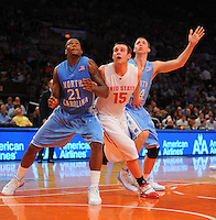 Ohio State center Kyle Madsen #15 fights for a rebound against North Carolina forward Deon Thompson #21 and David Wear #34 against the North Carolina Tarheels during the 2K Sports Classic at Madison Square Garden. (Mandatory Credit: Delane B. Rouse/Delane Rouse Photography)