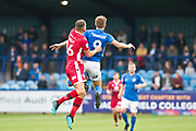 Macclesfield Town forward Joe Ironside and Morecambe defender Sam Lavelle in a challenge during the EFL Sky Bet League 2 match between Macclesfield Town and Morecambe at Moss Rose, Macclesfield, United Kingdom on 20 August 2019.