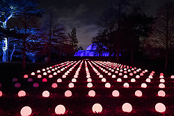 © Licensed to London News Pictures. 21/11/2017. London, UK. A sequenced display of illuminated spheres lights the way the the Palm House at the opening of Christmas at Kew at Royal Botanical Gardens, Kew. The spectacular displays are illuminated by over one million tiny twinkling lights placed all over Kew Gardens - open Wednesdays – Sundays from 22 November 2017 – 2 January 2017. London, UK. Photo credit: Peter Macdiarmid/LNP