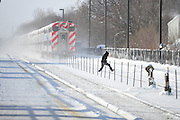 A Metra commuter crosses over snow drifts on the tracks at 159th Station, Monday, January 6th, 2013, in Oak Forest.