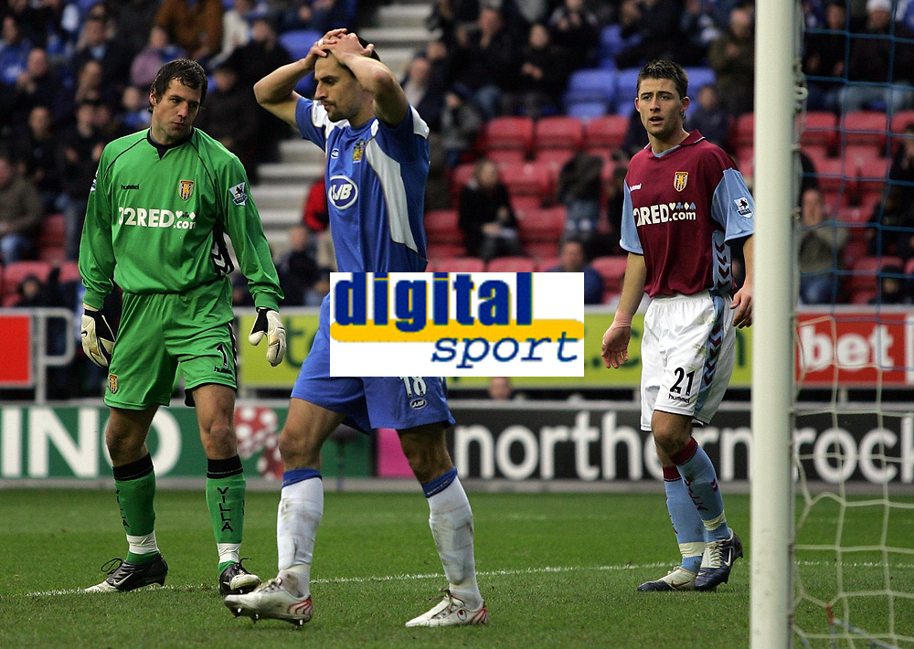 Photo: Paul Thomas.<br /> Wigan Athletic v Aston Villa. The Barclays Premiership. 19/11/2006.<br /> <br /> Paul Scharner of Wigan (18) puts his hands on his head after he knows he should have scored as Villa players Thomas Sorensen (Green) and Gary Cahill breathe a sigh of relief.