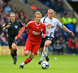 BOLTON, ENGLAND - Saturday, August 29, 2009: Liverpool's Lucas Leiva is tackled by Bolton Wanderers' Sean Davis, which leads to the Bolton player's red card, during the Premiership match at the Reebok Stadium. (Photo by David Rawcliffe/Propaganda)
